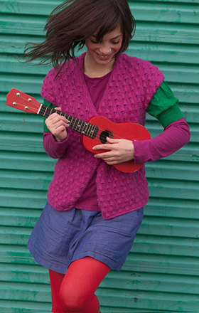 Girl smiling with Ukulele